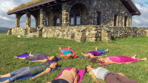 Performing yoga nidra outdoors on a grassy hillside