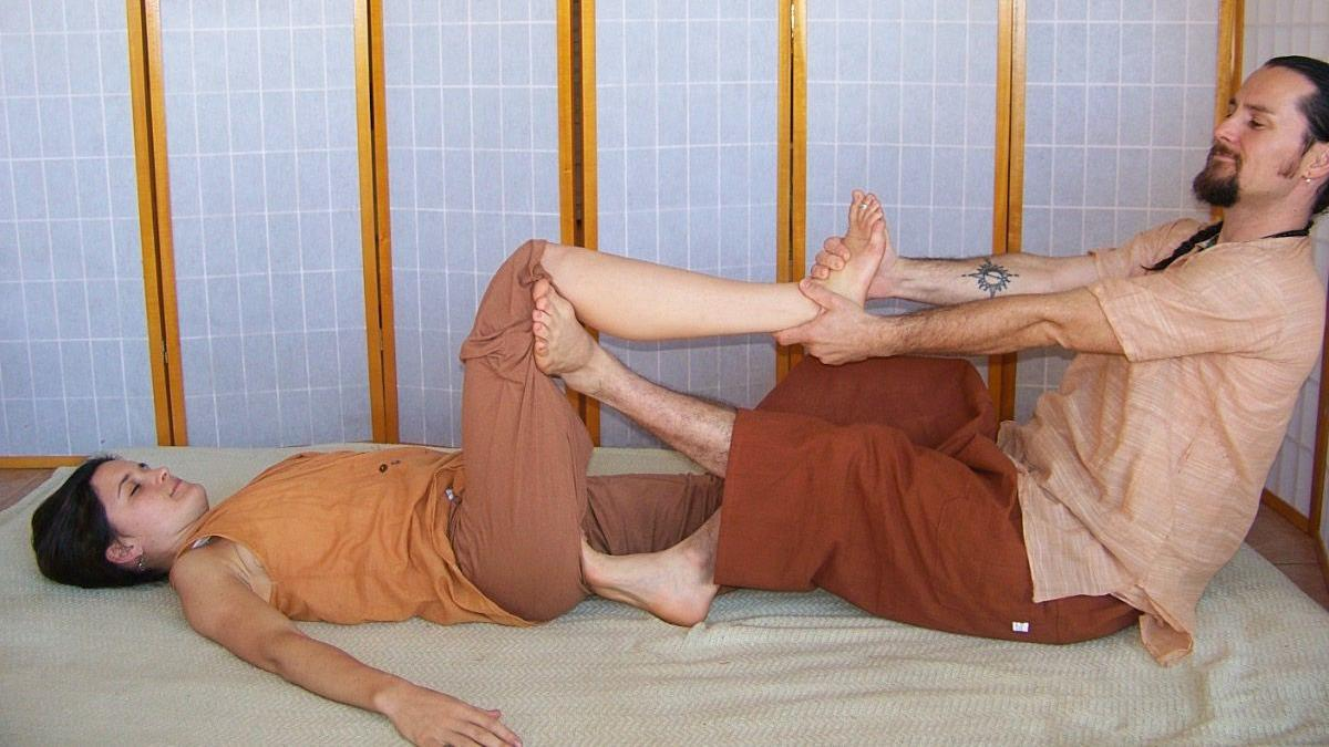 Krishna and Aiyana demonstrate Thai massage