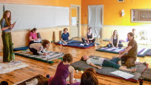 Krishna Perry leads a Thai massage class