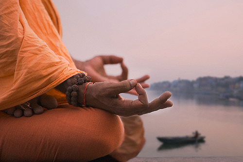 a monk sitting in Chin Mudra